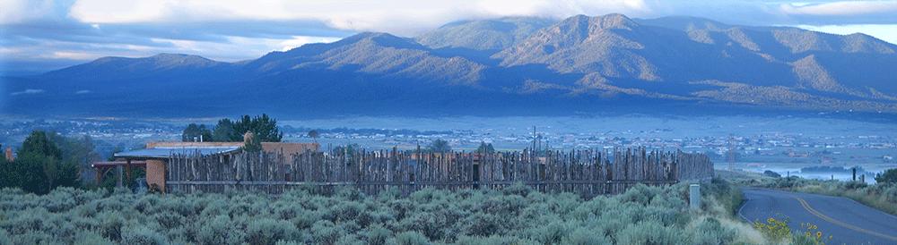 The town of Taos spread out beneath the Sangre de Cristo mountains.